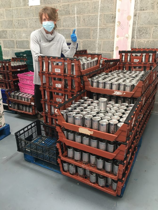 Social Bite sorting our tins of soup into care packages to be sent out around Scotland